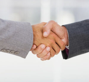 Closeup of a businesspeople shaking hands together